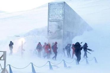 Journalists near the entrance of the Svalbard GLobe Seed Vault in Norway.
